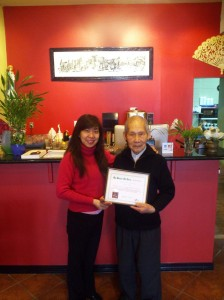 Pho La Vang showing off their winning certificate!
